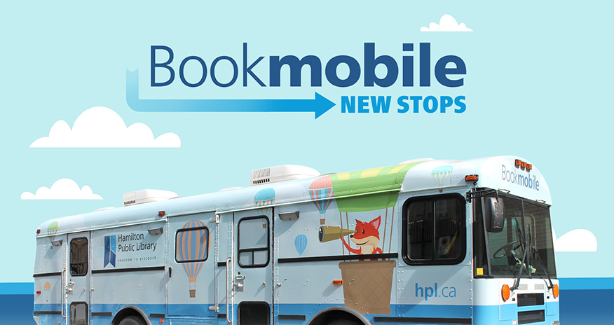 photo of bookmobile with cloud backrounds