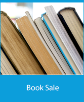 Closeup of books on a shelf with the text Book Sale
