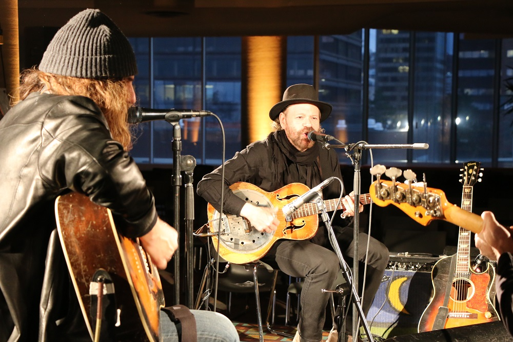 Photo of Colin Linden and Tom Wilson doing a sound check before the Blackie and the Rodeo Kings concert