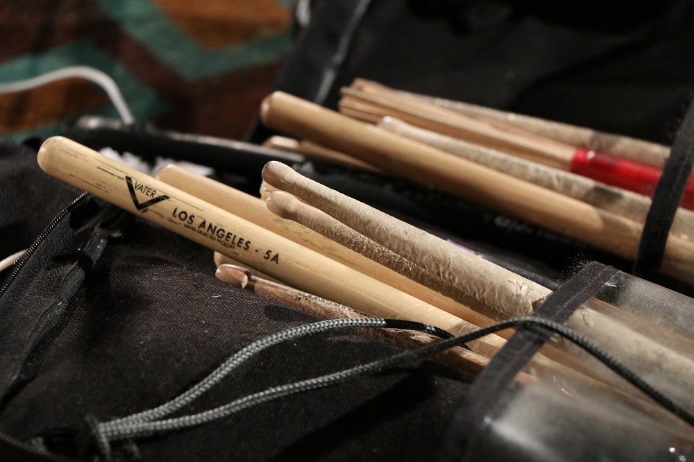 Closeup of drumsticks at the Blackie and the Rodeo Kings concert