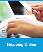 Text: Shopping Online, Image: Closeup of a hand holding a credit card next to a laptop