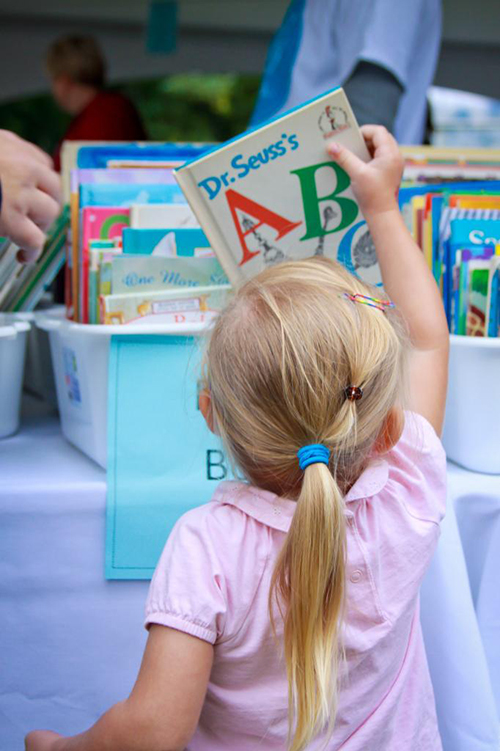 Child picking out a book at the Telling Tales Festival