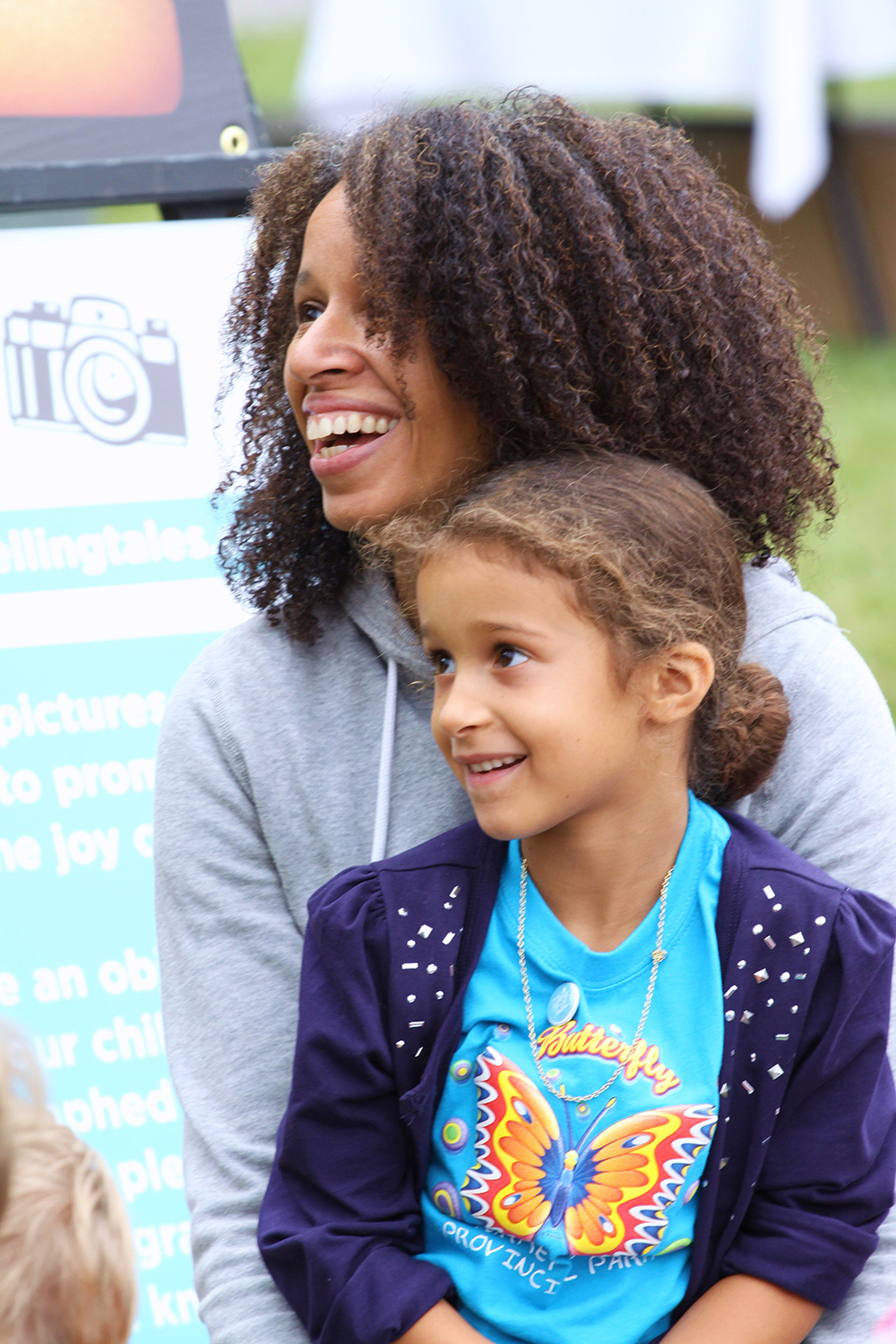 Mother and daughter watching a performance at the Telling Tales Festival
