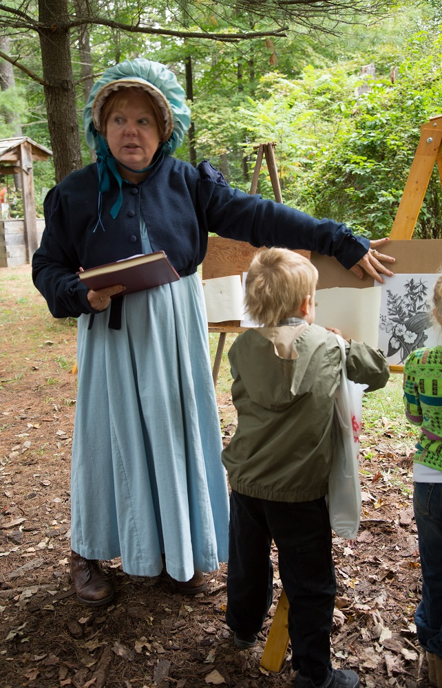 Woman dressed in an old fashioned costume at the Telling Tales Festival