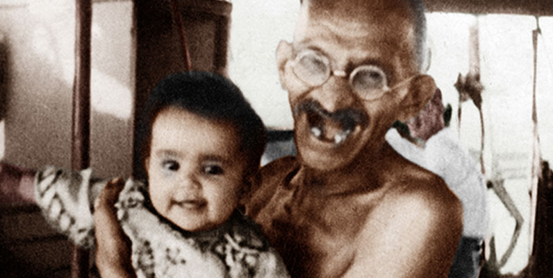 Gandhi carrying a baby