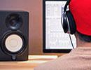 man wearing headphones using recording software
