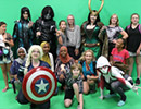 A group of people all dressed in Cosplay of various super heroes