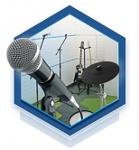 A hexagon graphic containing a microphone and music equipment