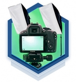 A hexagon graphic containing a digital camera and photo lighting equipment