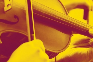 a close up image of a person playing the violin