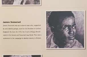 an image on a tarp exihibit of james somerset with text relaying his expereince during slavery