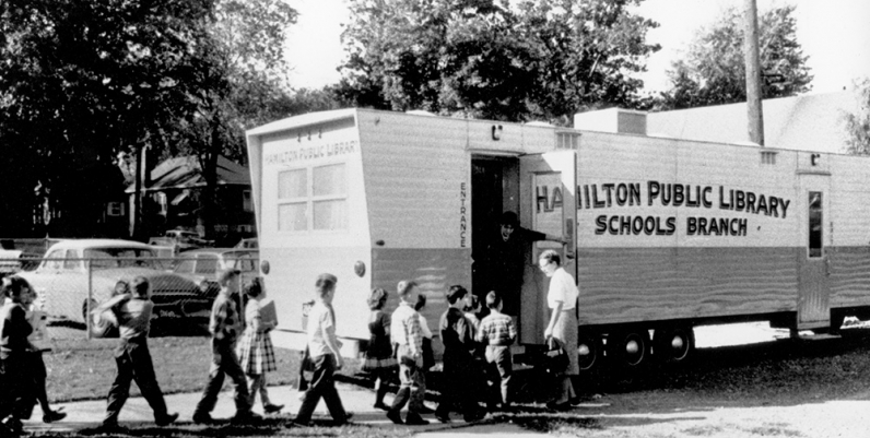 Archival photo of children entering the Hamilton Public Library Bookmobile circa 1960s