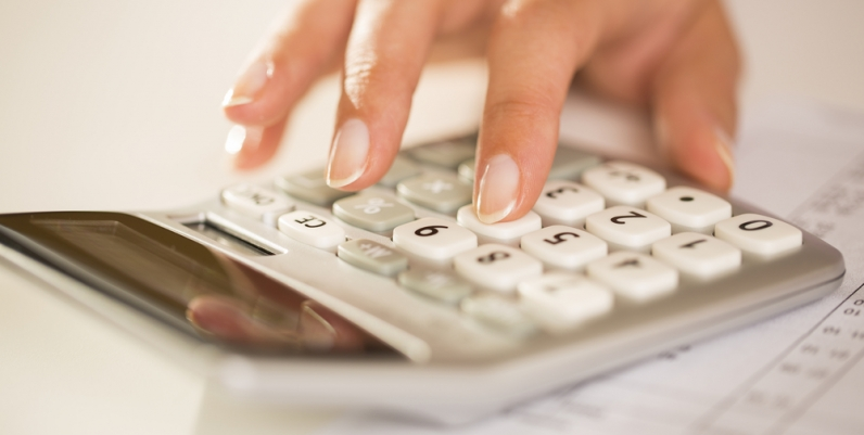 Closeup of a woman's hand using a calculator