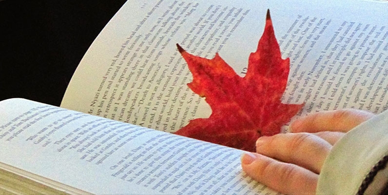 open book with a maple leaf
