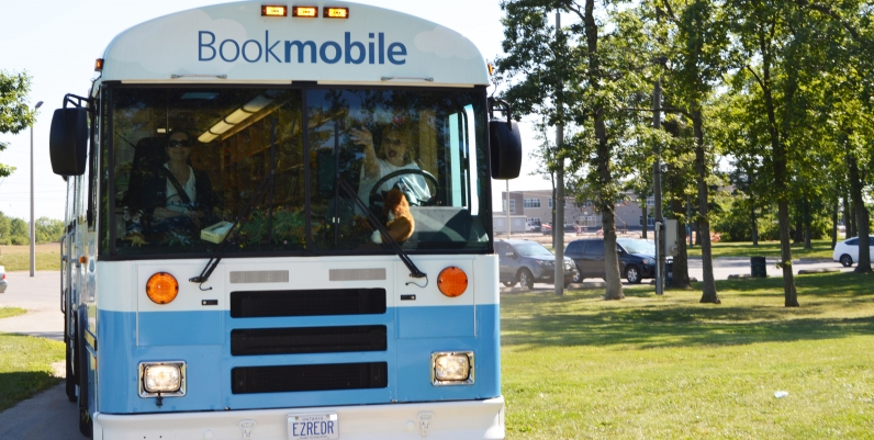 photo of a bookmobile bus in a park