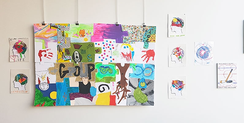 various art works done in different media on a wall