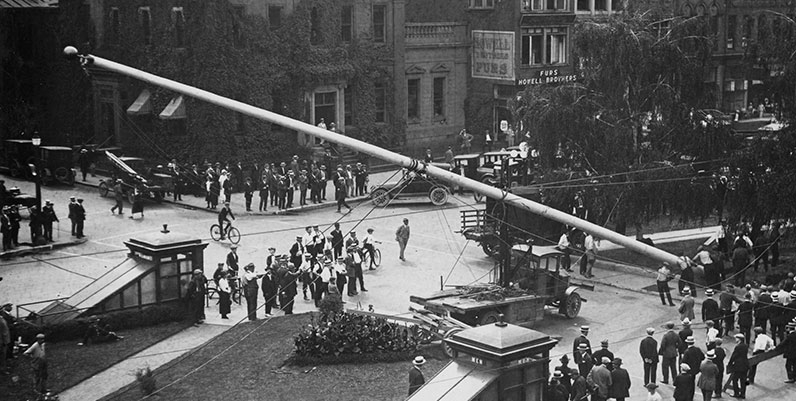 archival photo of a flagpole being raised in Gore Park