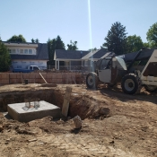 Foundation and machinery at the Greensville branch construction site.