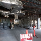 Valley park branch construction. Inside of building pictured with a caution sign