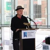 a man speaking behind a podium