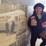 female posing in front of bookmobile wall photo