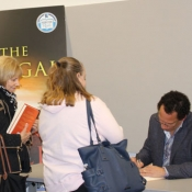 author signing books for readers