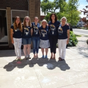 Ancaster staff members standing outside near all the sidwalk chalk drawings