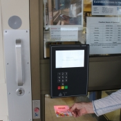 Using a library card to open the door to the Freelton Library