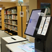 The self checkout and book return box inside the Freelton branch