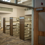 Some empty bookshelves inside the new greensville branch