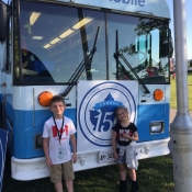Two kids leaning against the front of the Bookmobile in Bayfront park