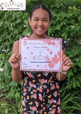 Ania, HPLs Junior Librarian in Residence holding her award
