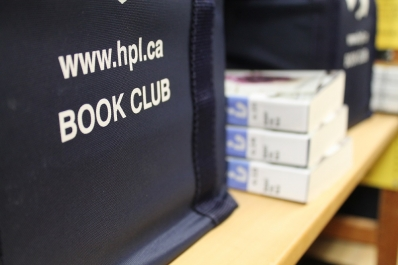 Photo of a library Book Club Kit sitting on a shelf