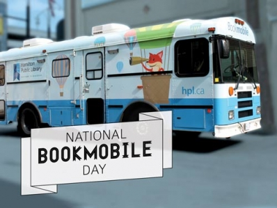 HPL bookmobile with text National Bookmobile Day on the lower left