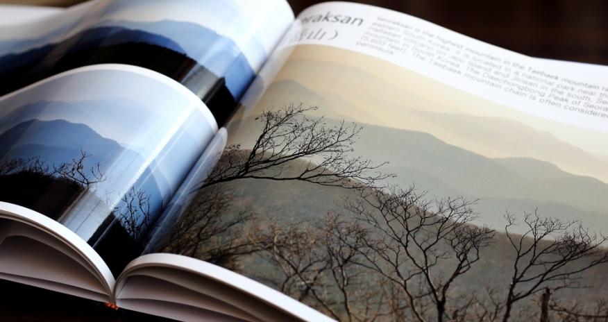 a photo of a an open art book