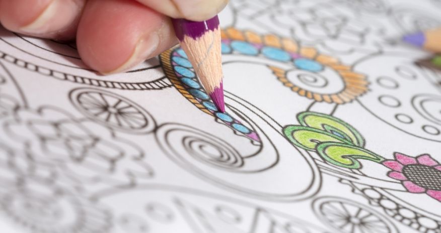 a close up of a hand colouring