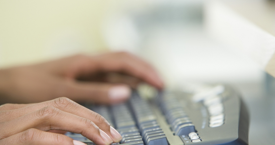 Closeup of hands on a keyboard
