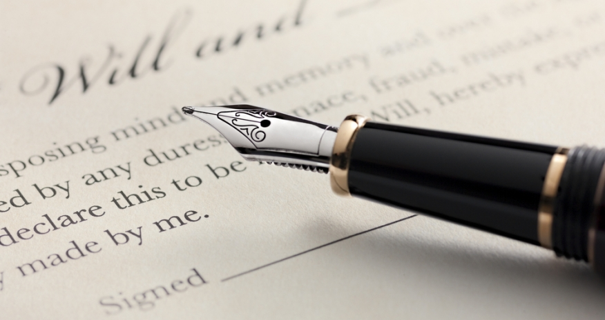 a close up photo of a fountain pen on a last will and testament