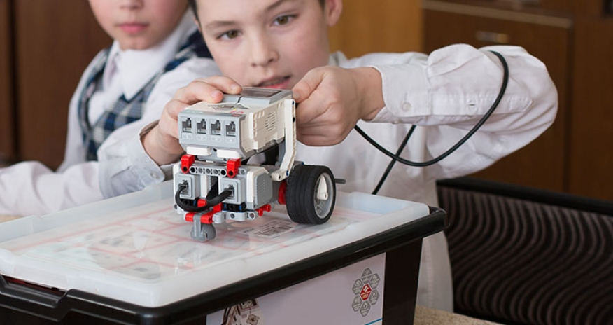 boy playing with LEGO Mindstorms