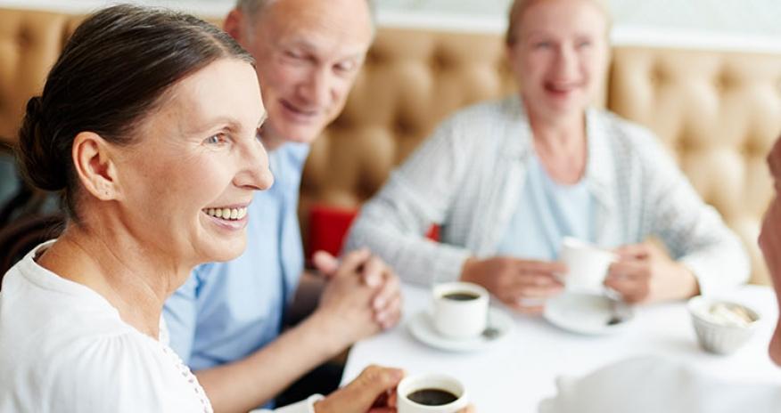 group of seniors having coffee