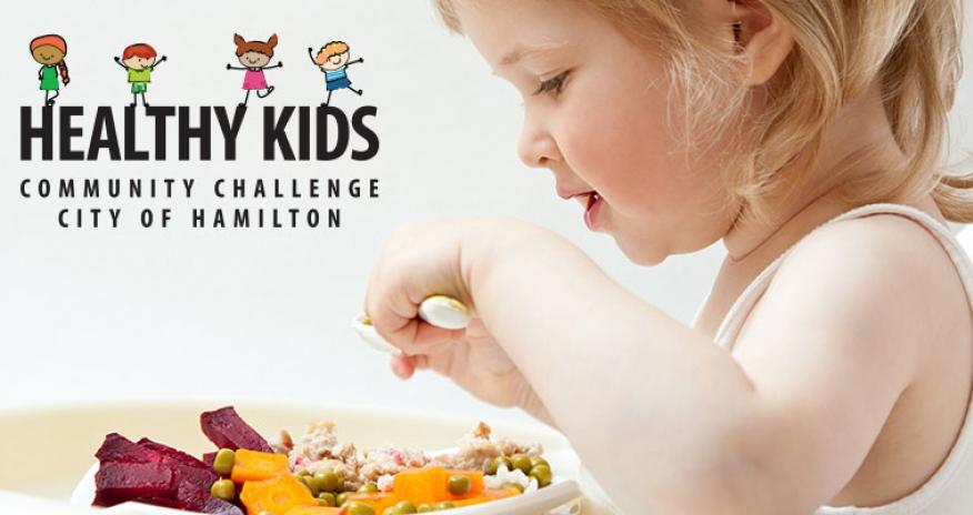 infant eating veggies