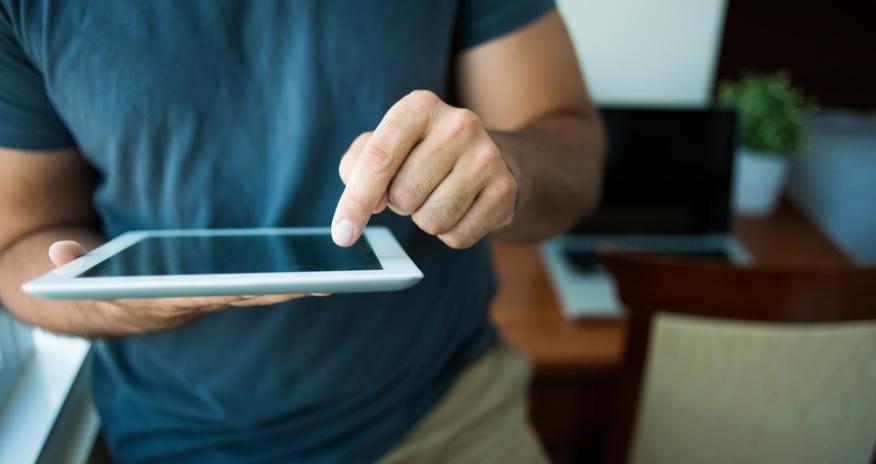 Closeup of a man using an iPad
