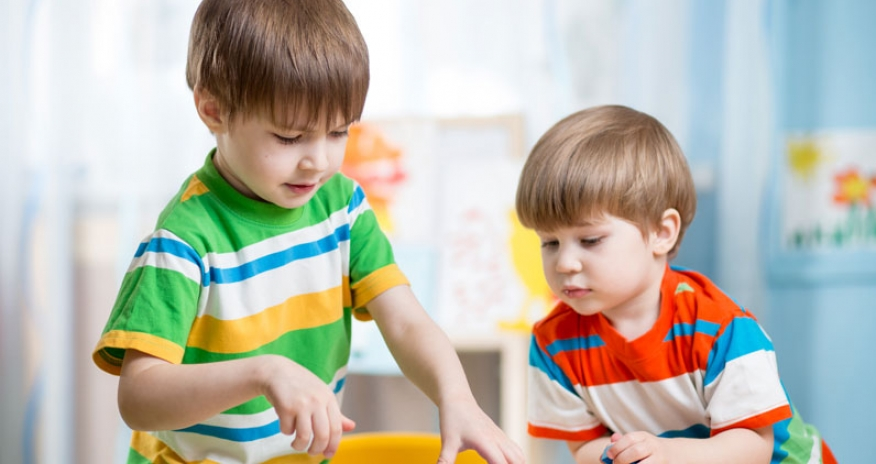 two boys playing at a table
